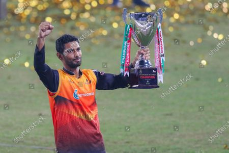 Gemcon Khulna cricket player Mahmudullah holds a trophy during the Bangabandhu T20 Cup 2020 Final between Gazi Group Chattagram and Gemcon Khulna at the Sher-e-Bangla National Cricket Stadium in Dhaka.