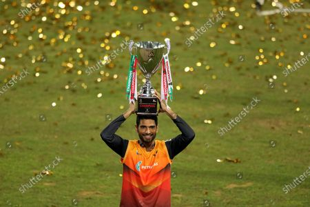 Gemcon Khulna cricket player, Mahmudullah holds a trophy during the Bangabandhu T20 Cup final 2020 between Gazi Group Chattogram and Gemcon Khulna at Sher e Bangla National Cricket Stadium.