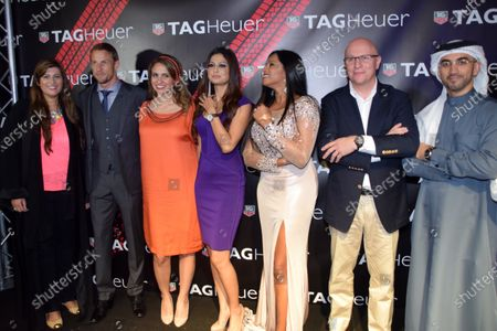 Stock Photo of Jenson Button (GBR) McLaren, and Stephane Linder, CEO of TAG Heuer, second right, at the unveiling of the TAG Heuer watch collection. Formula One World Championship, Rd19, Abu Dhabi Grand Prix, Qualifying, Yas Marina Circuit, Abu Dhabi, UAE, Saturday 22 November 2014.