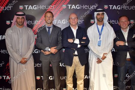 Stock Picture of Jenson Button (GBR) McLaren, and Stephane Linder, CEO of TAG Heuer, centre, at the unveiling of the TAG Heuer watch collection. Formula One World Championship, Rd19, Abu Dhabi Grand Prix, Qualifying, Yas Marina Circuit, Abu Dhabi, UAE, Saturday 22 November 2014.
