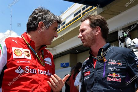 Marco Mattiacci (ITA) Ferrari Team Principal and Christian Horner (GBR) Red Bull Racing Team Principal. Formula One World Championship, Rd18, Brazilian Grand Prix, Race, Sao Paulo, Brazil, Sunday 9 November 2014.