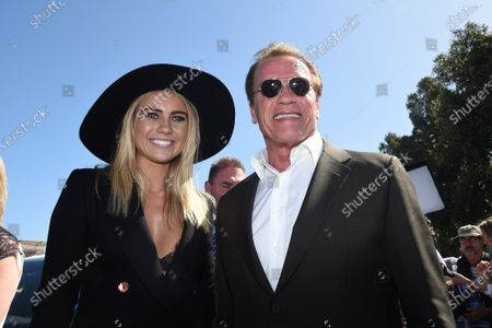 Arnold Schwarzenegger (AUT) and Elyse Knowles (AUS) Model at Formula One World Championship, Rd1, Australian Grand Prix, Race, Albert Park, Melbourne, Australia, Sunday 15 March 2015. BEST IMAGE