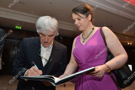 (L to R): Bernie Ecclestone (GBR) CEO Formula One Group (FOM) and Caroline Reid (GBR) Formula Money. Zoom Auction in aid of Great Ormond Street Hospital, Intercontinental Park Lane Hotel, London, Friday 7 February 2014.