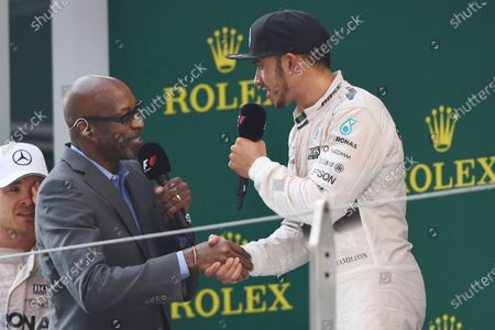 Ed Moses (USA) Legendary 400 meter runner talks to race winner Lewis Hamilton (GBR) Mercedes AMG F1 on the podium at Formula One World Championship, Rd3, Chinese Grand Prix, Race, Shanghai, China, Sunday 12 April 2015. BEST IMAGE