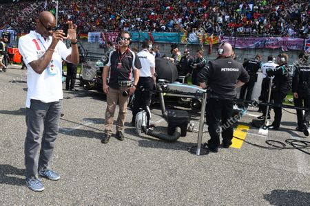 Ed Moses (USA) Legend 400 meters hurdler on the grid taking photos as Ted Kravitz (GBR) Sky TV looks on at Formula One World Championship, Rd3, Chinese Grand Prix, Race, Shanghai, China, Sunday 12 April 2015.