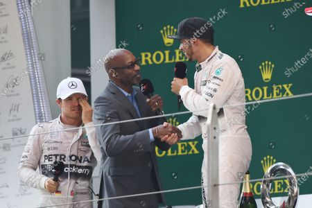 Ed Moses (USA) Legendary 400 meter runner talks to race winner Lewis Hamilton (GBR) Mercedes AMG F1 on the podium at Formula One World Championship, Rd3, Chinese Grand Prix, Race, Shanghai, China, Sunday 12 April 2015.