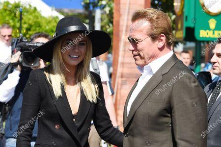 Arnold Schwarzenegger (AUT) Actor and Elyse Knowles (AUS) Model at Formula One World Championship, Rd1, Australian Grand Prix, Race, Albert Park, Melbourne, Australia, Sunday 15 March 2015.