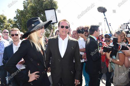 Arnold Schwarzenegger (AUT) and Elyse Knowles (AUS) Model at Formula One World Championship, Rd1, Australian Grand Prix, Race, Albert Park, Melbourne, Australia, Sunday 15 March 2015.