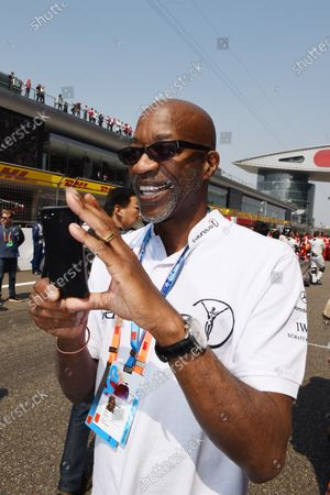 Ed Moses (USA) Legend 400 meters hurdler on the grid taking photos at Formula One World Championship, Rd3, Chinese Grand Prix, Race, Shanghai, China, Sunday 12 April 2015.