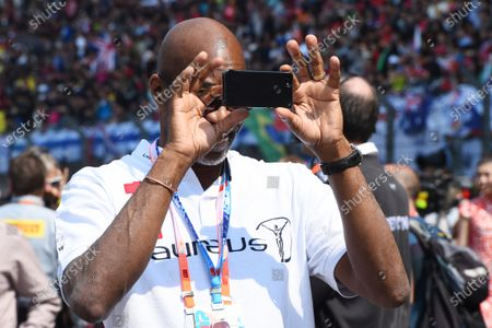 Ed Moses (USA) Legend 400 Meters hurdler taking photos on the grid at Formula One World Championship, Rd3, Chinese Grand Prix, Race, Shanghai, China, Sunday 12 April 2015.