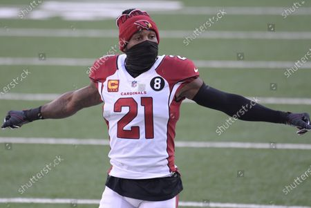 Arizona Cardinals cornerback Patrick Peterson (21) stretches during the first half of an NFL football game against the New York Giants, in East Rutherford, N.J