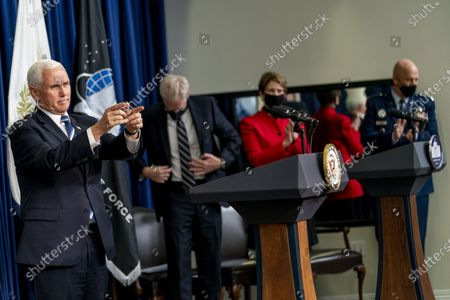 From left, Vice President Mike Pence, accompanied by Acting Defense Secretary Chris Miller, Secretary of the Air Force Barbara Barrett, and Chief of Space Operations at U.S. Space Force Gen. John Raymond, concedes a ceremony to commemorate the first birthday of the U.S. Space Force at the Eisenhower Executive Office Building on the White House complex, in Washington