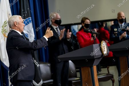 Stock Photo of From left, Vice President Mike Pence, accompanied by Acting Defense Secretary Chris Miller, Secretary of the Air Force Barbara Barrett, and Chief of Space Operations at U.S. Space Force Gen. John Raymond, concedes a ceremony to commemorate the first birthday of the U.S. Space Force at the Eisenhower Executive Office Building on the White House complex, in Washington