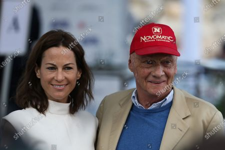 Stock Image of Niki Lauda (AUT) and girlfriend Birgit Wetzinger (AUT) at Amber Lounge Fashion Show, Le Meridien Beach Plaza, Monte Carlo, Monaco, 22 May 2015.