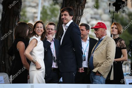 Niki Lauda (AUT) with girlfriend Birgit Wetzinger (AUT) and Toto Wolff (AUT) Mercedes AMG F1 Director of Motorsport at Amber Lounge Fashion Show, Le Meridien Beach Plaza, Monte Carlo, Monaco, 22 May 2015.