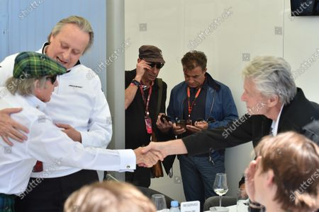 Sir Jackie Stewart (GBR) and Mansour Ojjeh (KSA) TAG with Michael Douglas (USA)  at Formula One World Championship, Rd7, Canadian Grand Prix, Qualifying, Montreal, Canada, Saturday 6 June 2015.
