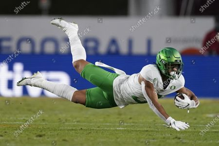 Oregon wide receiver Johnny Johnson III (3) catches a pass during the second quarter of an NCAA college football game for the Pac-12 Conference championship against Southern California, in Los Angeles