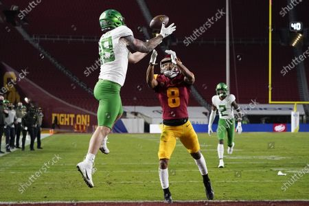 Oregon tight end Hunter Kampmoyer (48) catches a pass in the end zone for a touchdown against Southern California cornerback Chris Steele (8) during the first quarter of an NCAA college football game for the Pac-12 Conference championship, in Los Angeles
