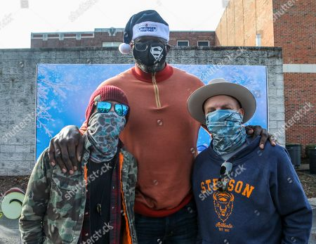 Stock Picture of (L-R) Preston Brust of musical group LoCash, former NBA star, Shaquille O'Neal, and Chris Lucas of LoCash attend Pepsi Stronger Together and the Shaquille O'Neal Foundation's Holiday Market at Jones Paideia Elementary School