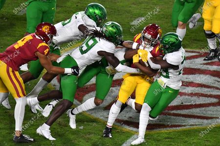 Los Angeles, CA.USC Trojans running back Stephen Carr #7 runs in action during the first quarter the Pac-12 Championship NCAA Football game between the USC Trojans and the Oregon Ducks at the Coliseum in Los Angeles, California..Mandatory Photo Credit: Louis Lopez/CSM