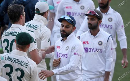 India's Virat Kohli, center, shakes hands with Australian players on the third day of their cricket test match at the Adelaide Oval in Adelaide, Australia, . Australia won the match