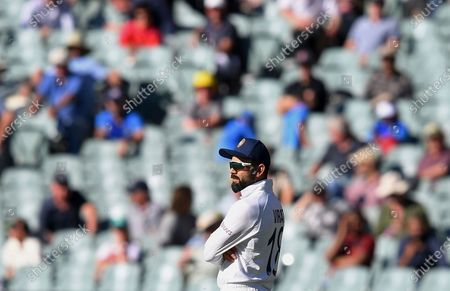 India's Virat Kohli stands with crossed arms near the end of their match against Australia on the third day of their cricket test match at the Adelaide Oval in Adelaide, Australia, . Australia won the match