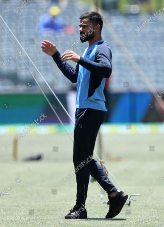 India's Virat Kohli warms up before the third day of their cricket test match against Australia at the Adelaide Oval in Adelaide, Australia