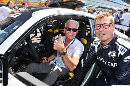 Bernd Maylander (GER) FIA Safety Car Driver and Philip Schofield (GBR) on the grid