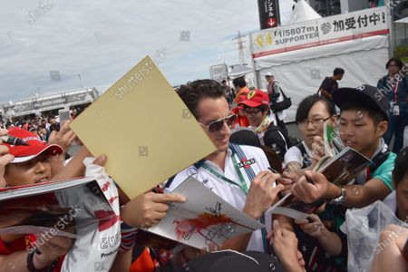 Adrian Sutil (GER) Williams Reserve Driver signs autographs for the fans at Formula One World Championship, Rd14, Japanese Grand Prix, Qualifying, Suzuka, Japan, Saturday 26 September 2015.