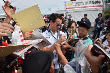 Adrian Sutil (GER) Williams Reserve Driver signs autographs for the fans at Formula One World Championship, Rd14, Japanese Grand Prix, Qualifying, Suzuka, Japan, Saturday 26 September 2015. BEST IMAGE
