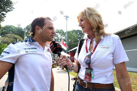 Louise Goodman (GBR) Goodman Media talks with Felipe Massa (BRA) Williams at Formula One World Championship, Rd13, Singapore Grand Prix, Race, Marina Bay Street Circuit, Singapore, Sunday 20 September 2015.