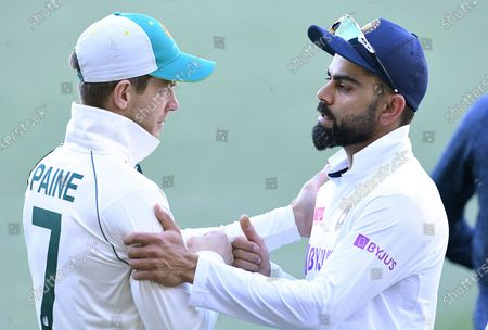 Captains Tim Paine of Australia (L) and Virat Kohli of India interact following Austraila's victory on day 3 of the first Test Match between Australia and India at Adelaide Oval, Adelaide, South Australia, Australia, 19 December 2020.