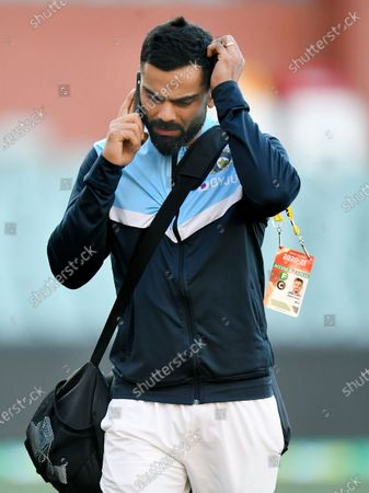 Indian captain Virat Kohli reacts during a telephone call as he leaves the stadium following Australia's victory on day 3 of the first Test Match between Australia and India at Adelaide Oval, Adelaide, South Australia, Australia, 19 December 2020.