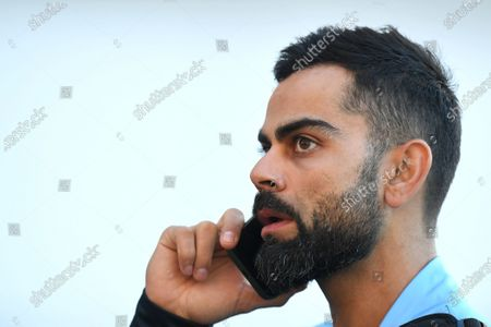 Indian captain Virat Kohli speaks on a phone as he leaves the stadium following Australia's victory on day 3 of the first Test Match between Australia and India at Adelaide Oval, Adelaide, South Australia, Australia, 19 December 2020.