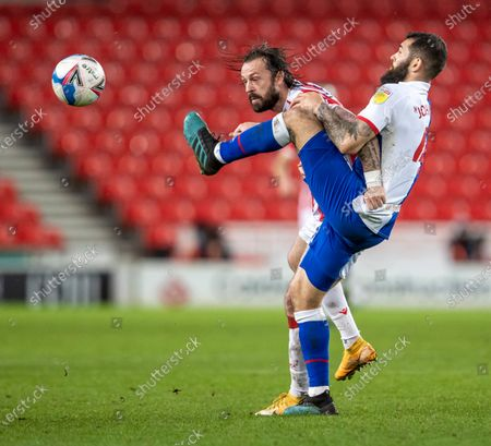 Steven Fletcher of Stoke City is tackled with a high boot by Bradley Johnson of Blackburn Rovers; Bet365 Stadium, Stoke, Staffordshire, England; English Football League Championship Football, Stoke City versus Blackburn Rovers.