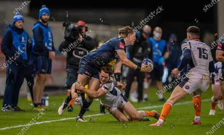 Sam James of Sale Sharks is tackled by Chris Dean of Edinburgh Rugby; AJ Bell Stadium, Salford, Lancashire, England; European Champions Cup Rugby, Sale Sharks versus Edinburgh.