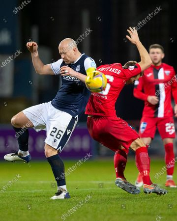 Charlie Adam of Dundee challenges for the ball with Steven Whittaker of Dunfermline Athletic; Dens Park, Dundee, Scotland; Scottish Championship Football, Dundee FC versus Dunfermline.