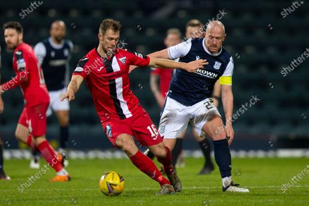 Steven Whittaker of Dunfermline Athletic holds the ball as Charlie Adam of Dundee tries to challenge; Dens Park, Dundee, Scotland; Scottish Championship Football, Dundee FC versus Dunfermline.