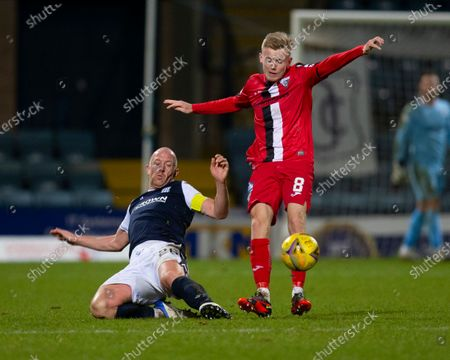 Kyle Turner of Dunfermline Athletic is tackled by Charlie Adam of Dundee; Dens Park, Dundee, Scotland; Scottish Championship Football, Dundee FC versus Dunfermline.