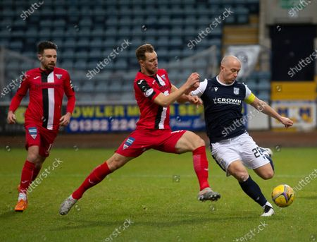 Steven Whittaker of Dunfermline Athletic challenges to block the shot from Charlie Adam of Dundee; Dens Park, Dundee, Scotland; Scottish Championship Football, Dundee FC versus Dunfermline.