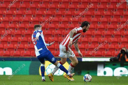 Steven Fletcher #21 of Stoke City  is fouled by Joe Rothwell #8 of Blackburn Rovers