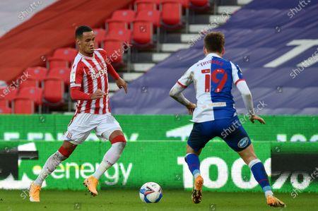 Thomas Ince #7 of Stoke City ahead of Tom Trybull #19 of Blackburn Rovers