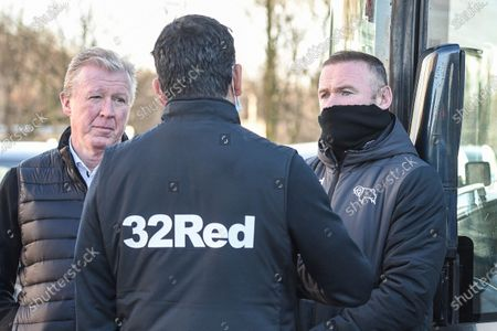 Technical director Steve McClaren and Manager of Derby County Wayne Rooney receives information of a Covid outbreak at Rotherham.