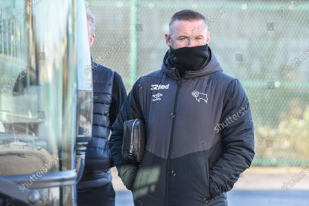 In the car park of the New York Stadium, Manager of Derby County Wayne Rooney awaits information of a Covid outbreak at Rotherham United squad, the Championship match was cancelled 90 minutes before kick off.