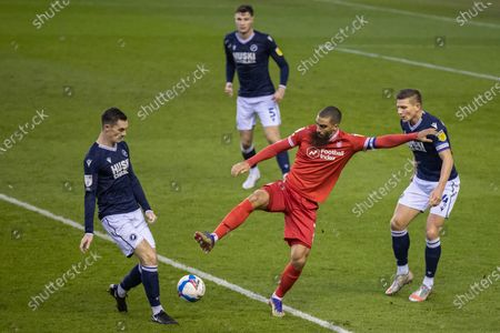 Lewis Grabban #7 of Nottingham Forest wins possession of the ball from Shaun Hutchinson #4 of Millwall as Shaun Williams #6 of Millwall comes in for a tackle