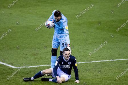 Bartosz Bialkowski #33 of Millwall checking on Shaun Williams #6 of Millwall