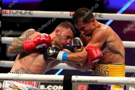 Stock Photo of Gennady Golovkin of Khazakhstan (R) punches Kamil Szeremeta of Poland during the IBF middleweight world title fight at the Seminole Hard Rock Hotel and Casino in Hollywood, Florida USA on 18, Dec 2020.