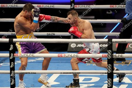 Gennady Golovkin of Khazakhstan gets punched by Kamil Szeremeta of Poland during the IBF middleweight world title fight at the Seminole Hard Rock Hotel and Casino in Hollywood, Florida USA on 18, Dec 2020.