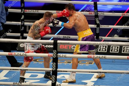 Kamil Szeremeta of Poland punches Gennady Golovkin of Khazakhstan during the IBF middleweight world title fight at the Seminole Hard Rock Hotel and Casino in Hollywood, Florida USA on 18, Dec 2020.