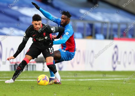 Liverpool's Alex Oxlade-Chamberlain, left, duels for the ball with Crystal Palace's Jeffrey Schlupp during the English Premier League soccer match between Crystal Palace and Liverpool at Selhurst Park stadium in London